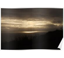 Sun breaking through cloud over the Atlantic Ocean at the Cliffs of Moher, Ireland Poster