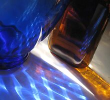Reflections and shadows through blue and amber glass by jsmusic