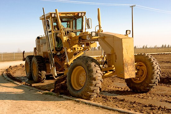 Yellow Grader Leveling at a Construction Site by Buckwhite