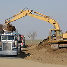 Heavy Machinery Excavating at a Construction Site by Buckwhite