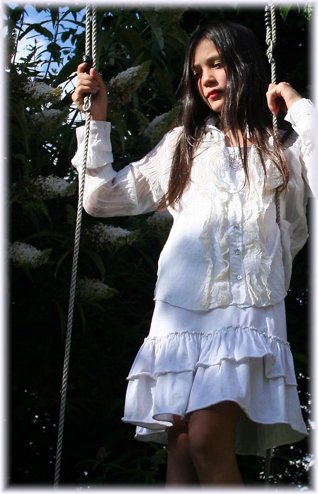 girl in a swing by Rebecca Tun