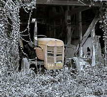 An old rusty tractor in a Norfolk Barn by johnny2sheds