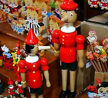 """Milan. """"Stop Following Me!"""" Pinocchios at a Toy Stand at a Street Market in Milan, Italy 2010 by Igor Pozdnyakov"""