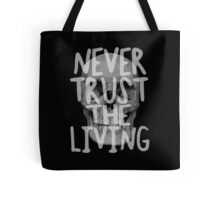 Never trust the living.  Tote Bag