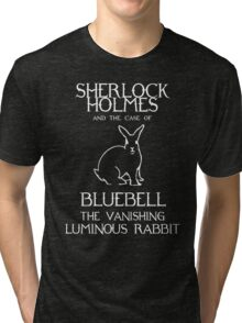 Sherlock Holmes and the case of Bluebell the vanishing luminous rabbit. Tri-blend T-Shirt