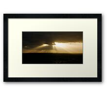 pierce the darkness Framed Print