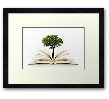 Tree growing from an open book, alternative recycling concept Framed Print