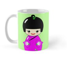 Cute Kokeshi dolls on green Mug