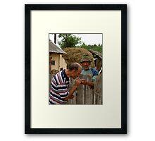 Romanian life - A helping hand Framed Print