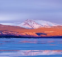 Snowy Mt Laurier frozen Lake Laberge Yukon Canada by ImagoBorealis