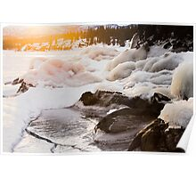Warmth of orange sunlight on ice covered rocks Poster