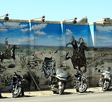 Cowboys Chasing Motorcycles by Susan Russell