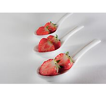 three strawberries in bed Photographic Print