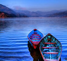 Canoes on Phewa Lake Nepal by marcpayne