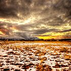 Snow and Clouds Sunset by Bob Larson