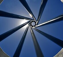 Spiral Sculpture on Blue Sky with Sun by rjmp