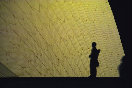 man infront of Opera House, Sydney by ccsad