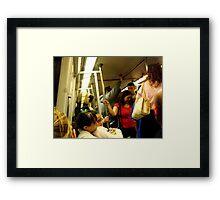 Riding the Metro Framed Print