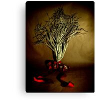 Desiccated Shrub with Ribbon on Brown Paper Canvas Print