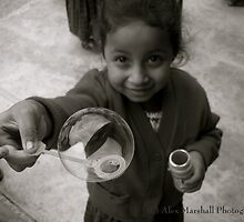 Mayan Child Having Fun With A Bubble by Alex Marshall