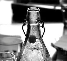 Bottle and glasses on table by GiulioSaggin