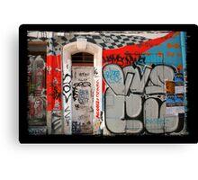 Wall, door and graffitis Canvas Print