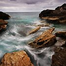 Waves Breaking on the Rocky Shore by Lucy Hollis