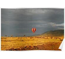 Balloon over the great wildebeest migration Poster