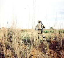 Soldier in the weeds by Benjamin Sloma