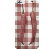 Still life of two red chili peppers iPhone Case/Skin