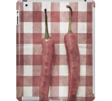 Still life of two red chili peppers iPad Case/Skin