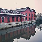 Red building on the river by Luca Renoldi