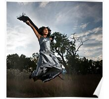 a young woman, in a silver dress, leaps into the air Poster