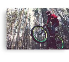 Bike jump in the forest Canvas Print