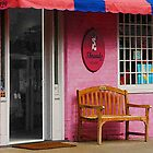 Dress Shop With Orange and Blue Awning by Susan Savad