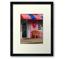 Dress Shop With Orange and Blue Awning Framed Print