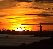 Sunset on Statue of Liberty by EHRETic