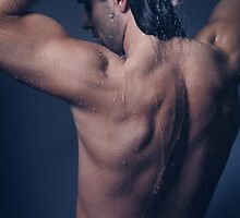 Portrait of man with wet bare torso in shower art photo print by ArtNudePhotos