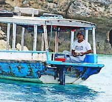 Boat pilot fishing off Pemeratan Island, Bali by Michael Brewer