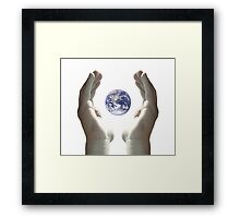 Earth in my hands Framed Print