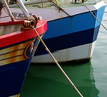 Red and blue Boats by Rick Dunstan