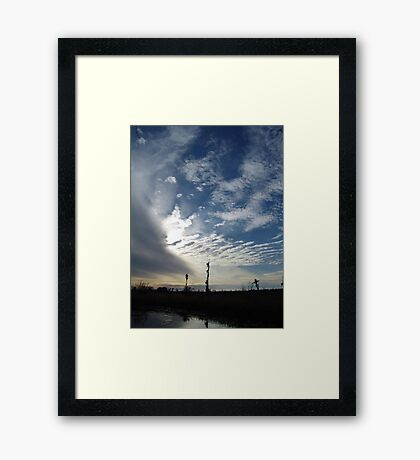 Blowing the Feathers Away Framed Print