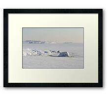 Snow covered coast Framed Print