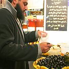 Buying Olives at the Market in the Medina in Tunis by Laurel Talabere