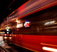 Piccadilly: Bus passing by. by JLaverty