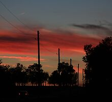 COUNTRY ROAD BLAZING RED SUNSET WITH CLOUD'S AND ROAD by ROBERTDBROZEK