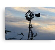 Windmill Sillouette with Gray, Blue Sky in Kansas Canvas Print