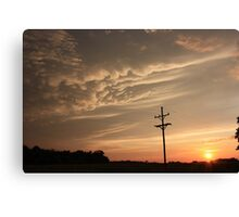 Puffy Cloud's on a Stormy night Canvas Print