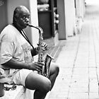 An Austin Street Musician Plays for Young Boy by SESE