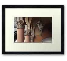 three columns and a streetlight Framed Print